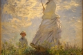 Claude Monet - Umbrella la passeggiata camille monet con il figlio jean sulla collina